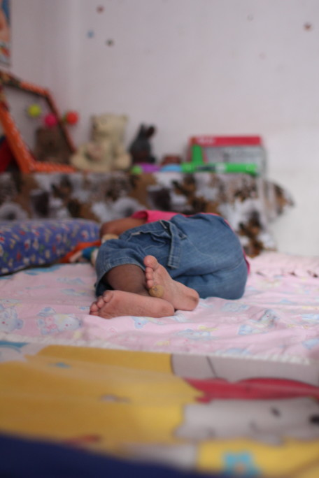 M napping in her bedroom at the orphanage Photo credit: Vasudha Sagar